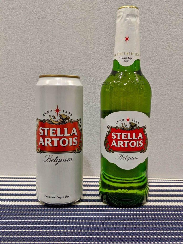 банка и бутылка пива стелла артуа