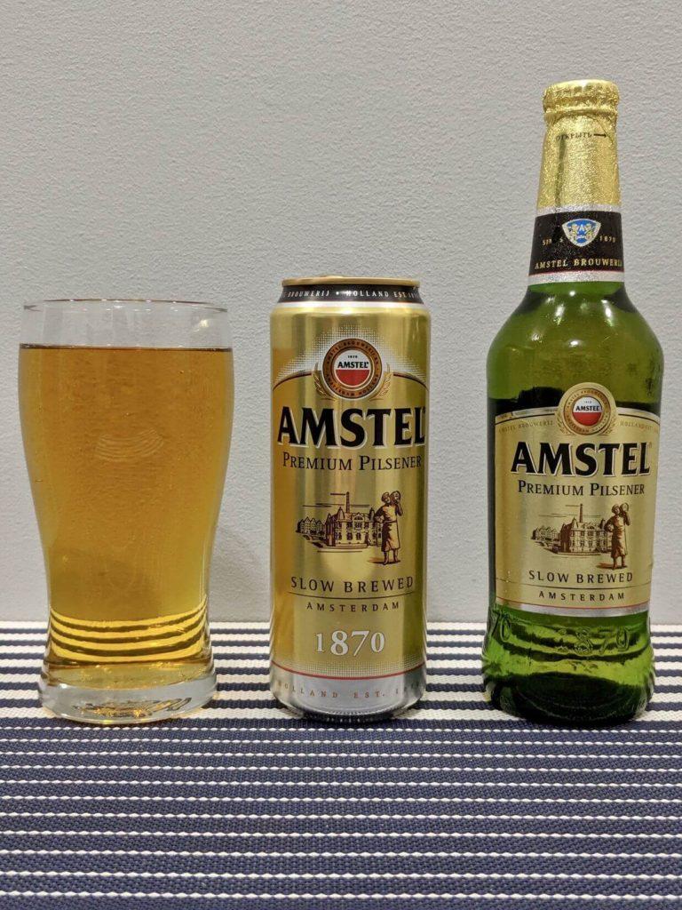 бутылка и стакан амстел пилснер